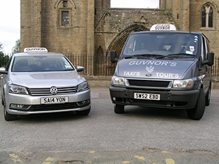 Taxis in front of Elgin Cathedral